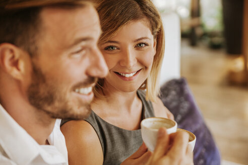 Portrait of smiling couple in a cafe - ZEDF00856