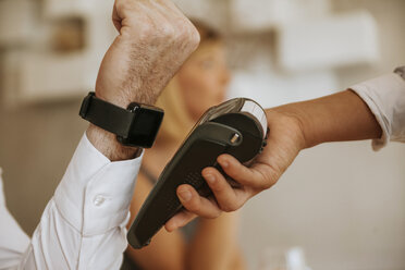 Contactless payment with smartwatch in cafe - ZEDF00883