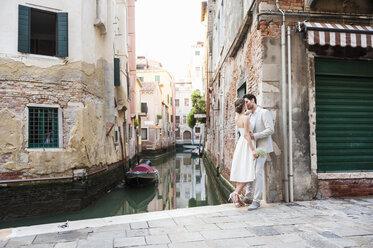 Italy, Venice, kissing bridal couple - DIGF02853