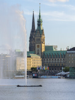 Germany, Hamburg, city hall and St Nikolai Memorial with Inner Alster and Alster fountain in the foreground - RJF00729