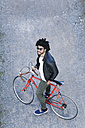 Elevated view of man with bicycle and sunglasses - SBOF00710