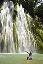 Dominican Republic, Samana, woman admiring huge waterfall - ECPF00110