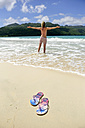 Dominican Republic, Samana, flip-flops on the beach and woman in the sea - ECPF00113