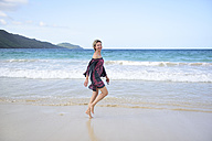 Dominican Republic, Samana, happy woman walking on the beach - ECPF00119