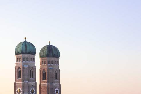 Germany, Munich, view to spires of Cathedral of Our Lady at twilight - MMAF00136