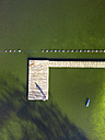 Aerial view of man standing on jetty at a lake - STSF01317