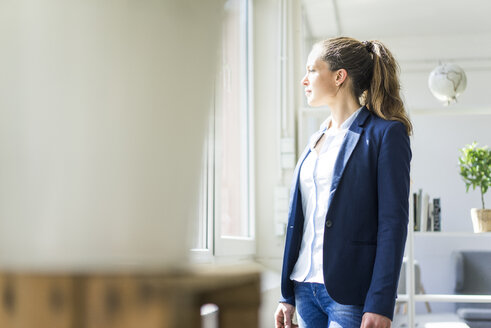Businesswoman looking out of window - JOSF01765