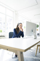 Portrait of businesswoman working at desk - JOSF01771
