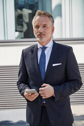 Portrait of businessman with cell phone - SUF00278
