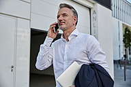 Portrait of businessman on the phone - SUF00296