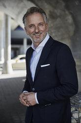 Portrait of smiling businessman wearing suit - SUF00299