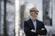 Smiling grey-haired businessman outdoors - SBOF00772