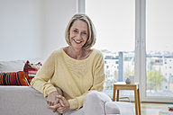 Portrait of happy mature woman at home on the sofa - RBF06037