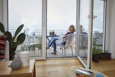 Mature woman at home sitting on balcony - RBF06046