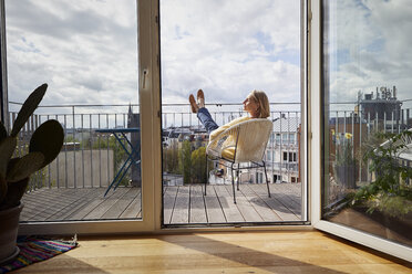Mature woman at home relaxing on balcony - RBF06058