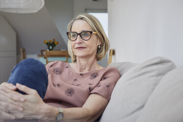 Mature woman at home on the sofa - RBF06067