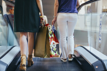 Customers with shopping bags on escalator - MOMF00238
