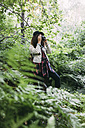 Teenage girl taking pictures in nature - VPIF00094