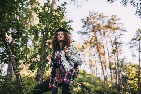 Portrait of  teenage girl with camera and backpack in nature - VPIF00097