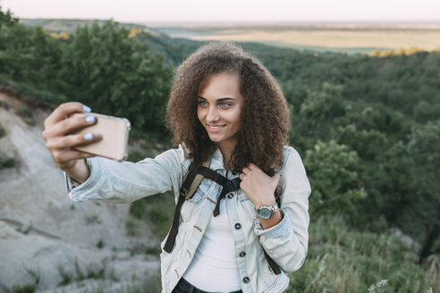 Smiling teenage girl taking selfie in nature - VPIF00136