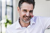 Portrait of smiling businessman - UUF11681