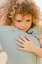 Portrait of little girl cuddling her uncle - NMSF00168