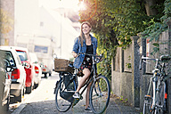 Young woan with bicycle in the city - MAEF12422