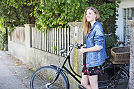 Young woan with bicycle in the city - MAEF12440