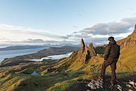 UK, Scotland, Inner Hebrides, Isle of Skye, Trotternish, tourist on peak near The Storr - FOF09391