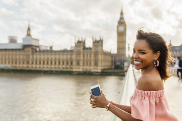 UK, London, portrait of smiling woman on Westminster Bridge - MGOF03651