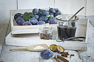 Preserving jar of plum jam, plums  and ingredients on wood - ASF06120
