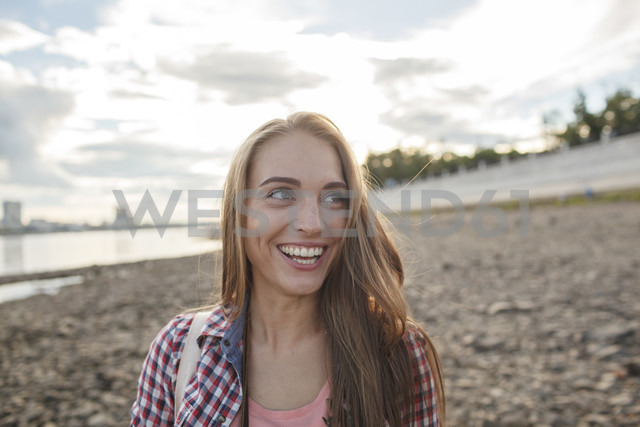 Happy young woman at the riverside - VPIF00166