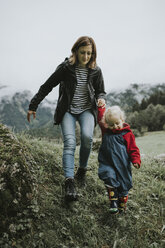 Austria, Vorarlberg, Mellau, mother and toddler on a trip in the mountains - DWF00309