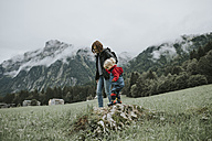 Austria, Vorarlberg, Mellau, mother and toddler on a trip in the mountains - DWF00312