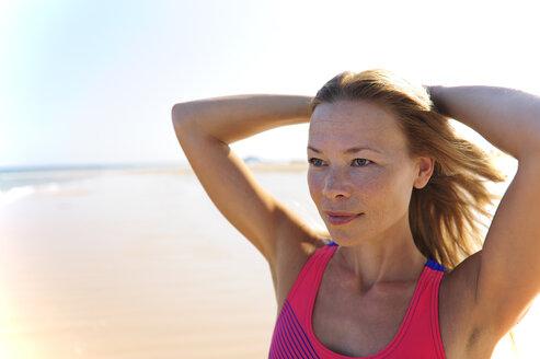 Portrait of woman on the beach - ECPF00141