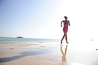 Egypt, Soma Bay, woman running on the beach - ECPF00144