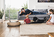 Father playing with his kids at home - UUF11774