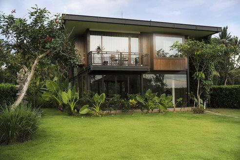 Modern design house surrounded by lush tropical garden - SBOF00849