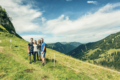 Germany, Bavaria, Pfronten, portrait of happy family on alpine meadow near Aggenstein - PNPF00014