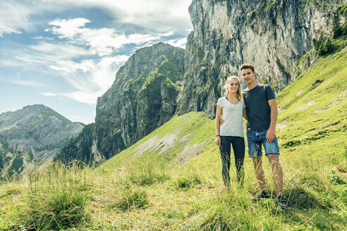 Germany, Bavaria, Pfronten, portrait of young couple on alpine meadow near Aggenstein - PNPF00017