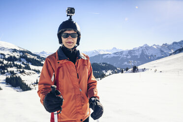 Austria, Damuels, skier with action cam in winter landscape - PNPF00047