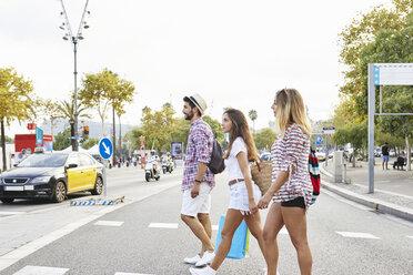 Three friends crossing a street - JRFF01454