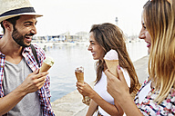 Three happy friends holding ice cream cones - JRFF01460