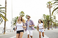 Spain, Barcelona, three tourists on the move in the city - JRFF01466