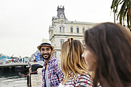 Spain, Barcelona, three tourists at a pier in the city - JRFF01469
