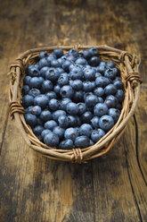 Wickerbasker of blueberries on wood - LVF06276