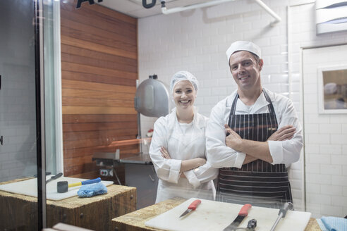 Portrait of smiling man and woman in butchery - ZEF14634
