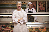 Portrait of smiling woman in butchery - ZEF14637
