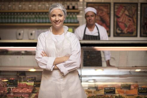 Portrait of smiling woman in butchery - ZEF14637