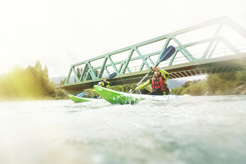 Germany, Bavaria, Allgaeu, couple kayaking on river Iller - PNPF00059